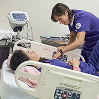 UW School of Nursing faculty and researcher practicing simulation.